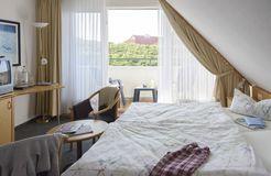 Double room standard with balcony (2/4) - Biohotel Strandeck