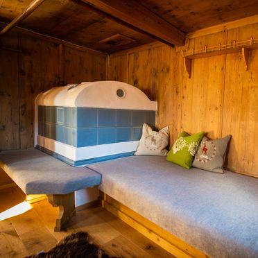 Wohnstube mit Kachelofen, Chalet Zellberg in Zellberg, Tirol, Tirol, Österreich
